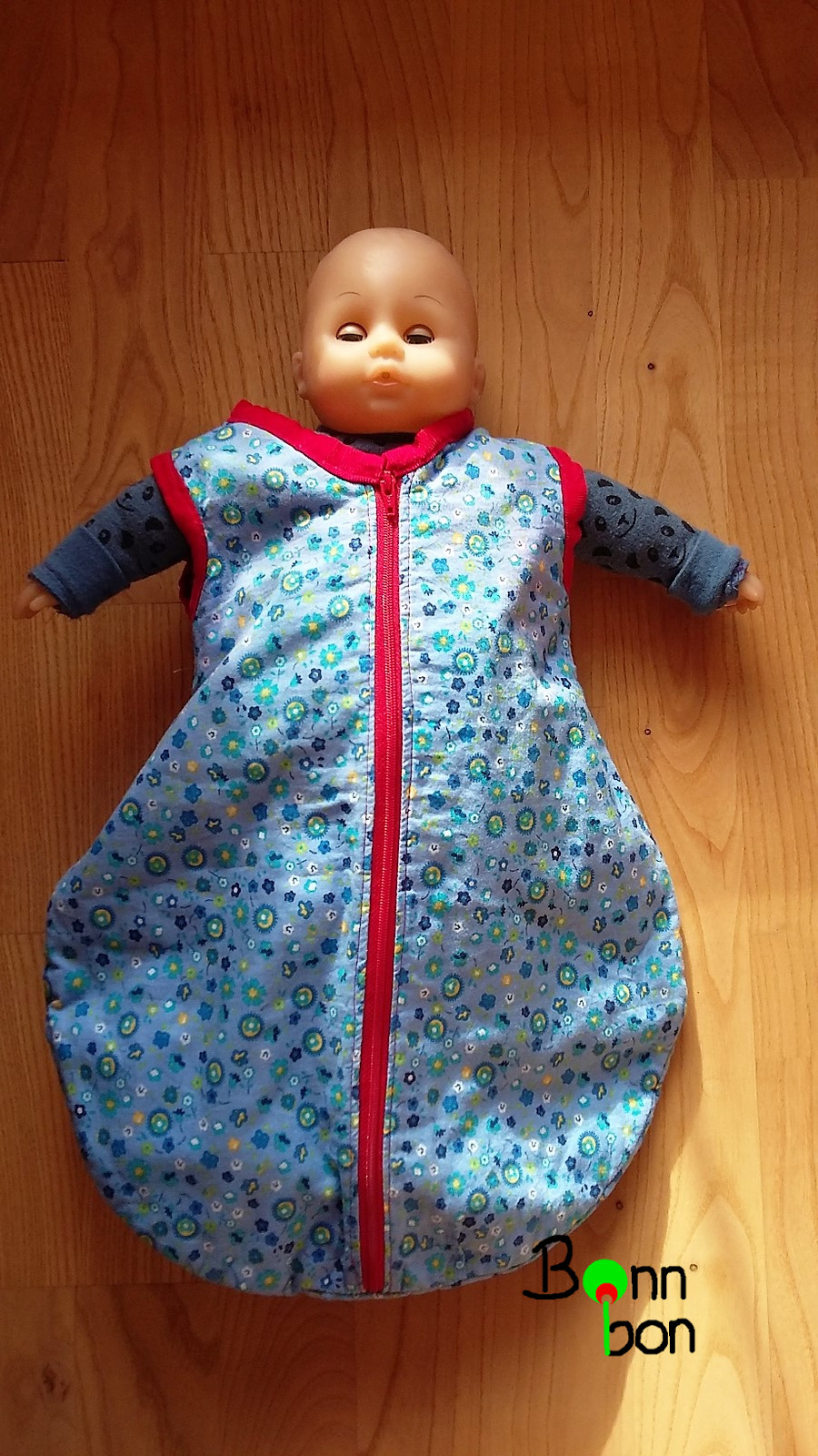 Puppenschlafsack und Puppe